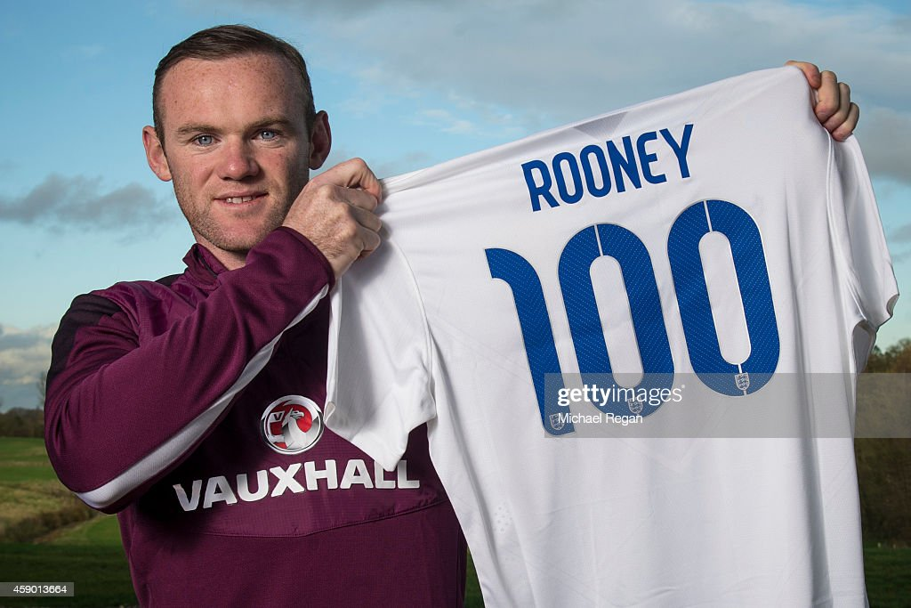 <a gi-track='captionPersonalityLinkClicked' href=/galleries/search?phrase=Wayne+Rooney&family=editorial&specificpeople=157598 ng-click='$event.stopPropagation()'>Wayne Rooney</a> of England poses with a shirt to celebrate him winning his 100th international cap which he hopes to gain by playing in the EURO 2016 Qualifier match between England and Slovenia on Saturday 15th November at St Georges Park on November 12, 2014 in Burton-upon-Trent, England.