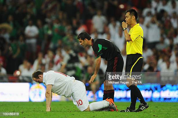 Wayne Rooney of England Rafael Marquez of Mexico and match referee Masaaki Toma are seen during the International Friendly match between England and...