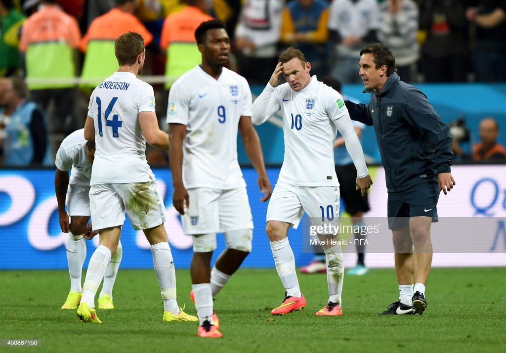 <a gi-track='captionPersonalityLinkClicked' href=/galleries/search?phrase=Wayne+Rooney&family=editorial&specificpeople=157598 ng-click='$event.stopPropagation()'>Wayne Rooney</a> of England (2nd R) reacts during the 2014 FIFA World Cup Brazil Group D match between Uruguay and England at Arena de Sao Paulo on June 19, 2014 in Sao Paulo, Brazil.