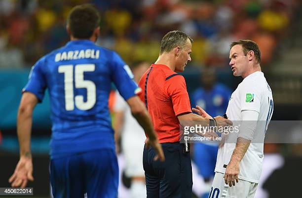 Wayne Rooney of England reacts toward referee Bjorn Kuipers during the 2014 FIFA World Cup Brazil Group D match between England and Italy at Arena...