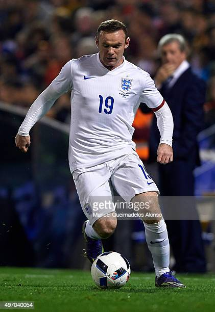 Wayne Rooney of England runs with the ball during the international friendly match between Spain and England at Jose Rico Perez Stadium on November...