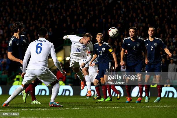 Wayne Rooney of England scores his team's second goal during the International Friendly match between Scotland and England at Celtic Park Stadium on...