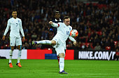 Wayne Rooney of England scores his team's second goal during the International Friendly match between England and France at Wembley Stadium on...