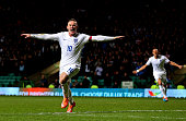 Wayne Rooney of England scores his team's third goal during the International Friendly match between Scotland and England at Celtic Park Stadium on...