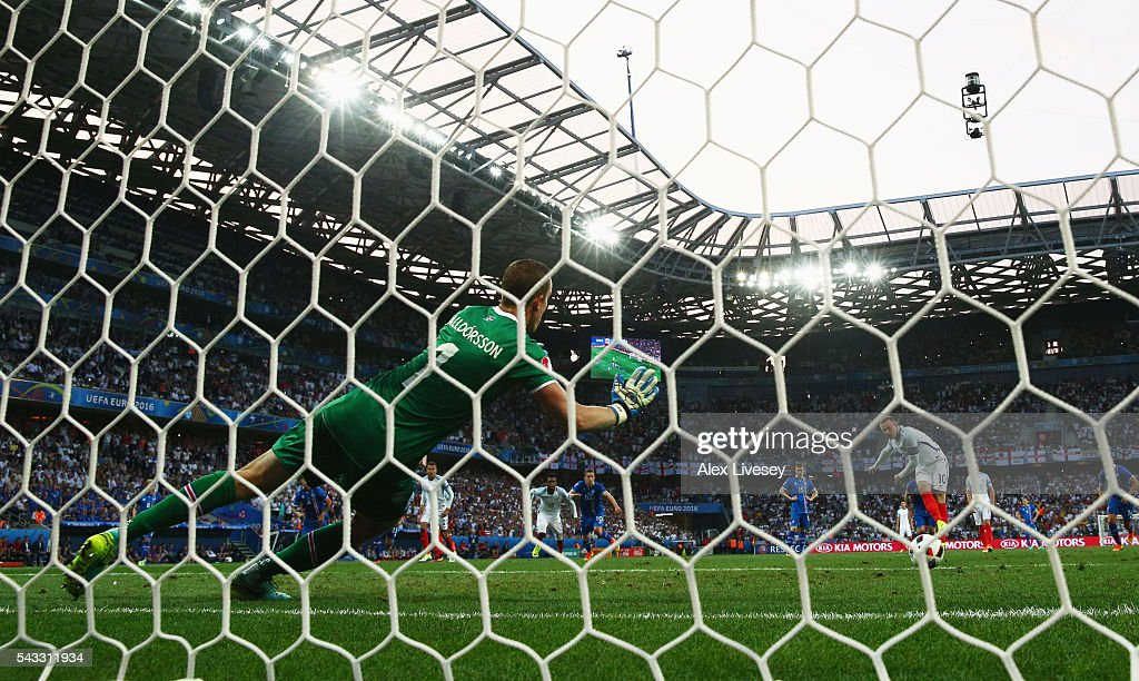<a gi-track='captionPersonalityLinkClicked' href=/galleries/search?phrase=Wayne+Rooney&family=editorial&specificpeople=157598 ng-click='$event.stopPropagation()'>Wayne Rooney</a> of England scores the opening goal from the penalty spot past Hannes Halldorsson of Iceland during the UEFA EURO 2016 round of 16 match between England and Iceland at Allianz Riviera Stadium on June 27, 2016 in Nice, France.