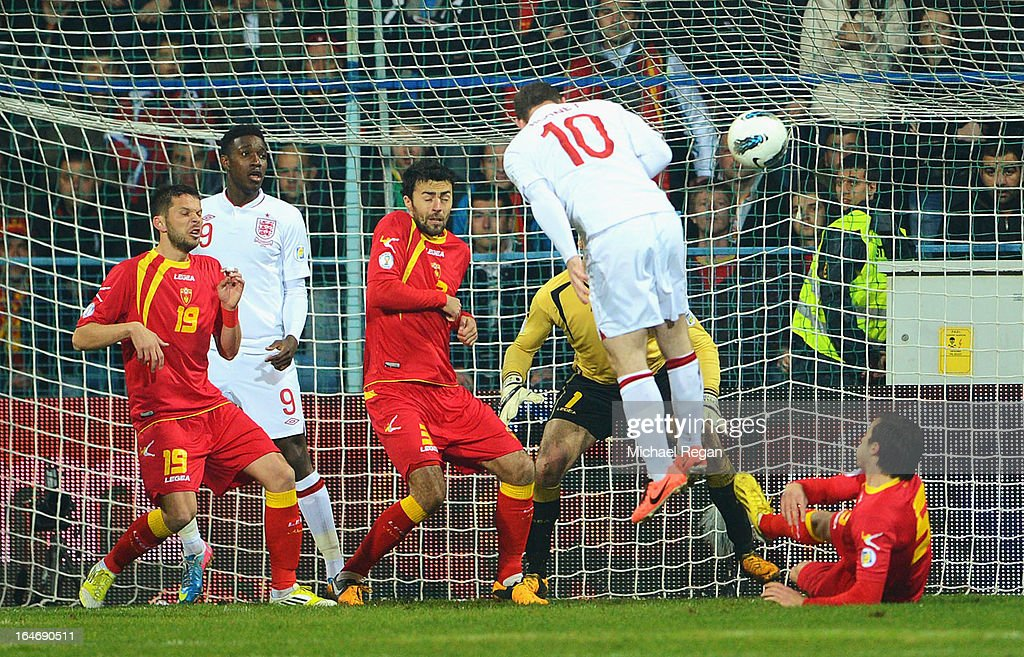 <a gi-track='captionPersonalityLinkClicked' href=/galleries/search?phrase=Wayne+Rooney&family=editorial&specificpeople=157598 ng-click='$event.stopPropagation()'>Wayne Rooney</a> of England scores the opening goal with a header during the FIFA 2014 World Cup Qualifier Group H match between Montenegro and England at City Stadium on March 26, 2013 in Podgorica, Montenegro.