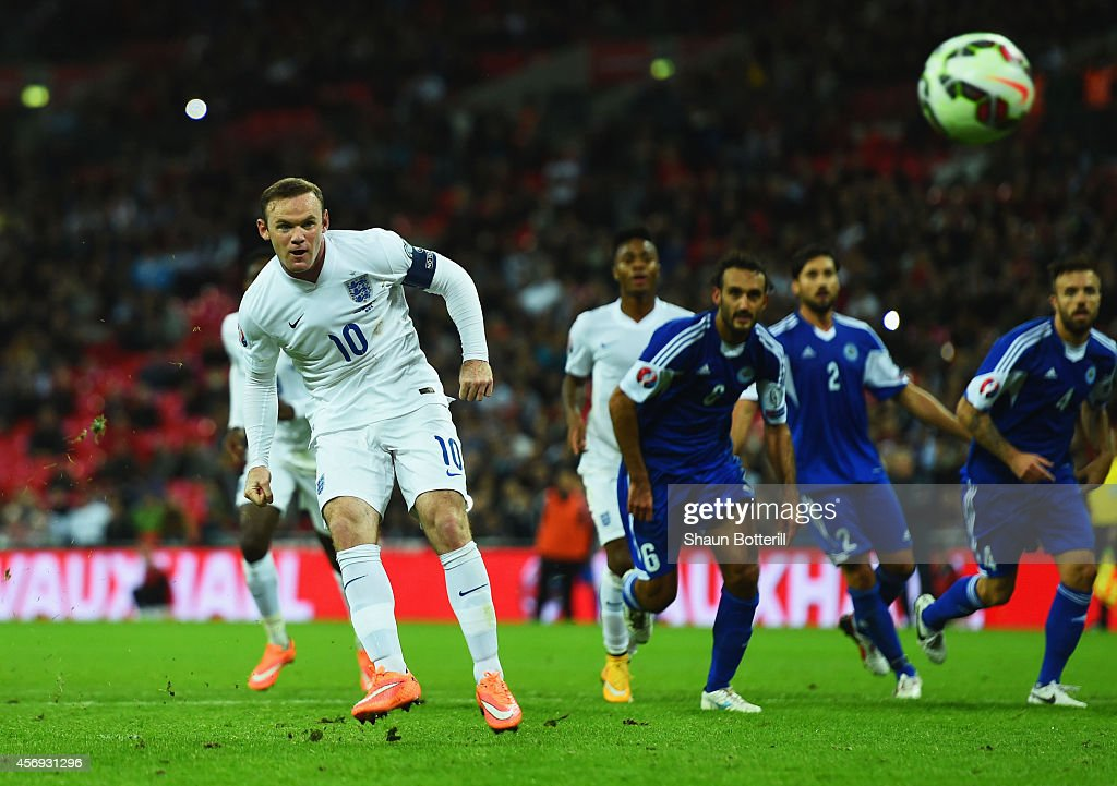 Wayne Rooney of England scores their second goal from the penalty spot during the EURO 2016 Group E Qualifying match between England and San Marino at Wembley Stadium on October 9, 2014 in London, England.