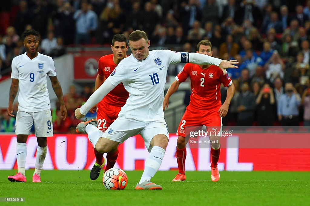 <a gi-track='captionPersonalityLinkClicked' href=/galleries/search?phrase=Wayne+Rooney&family=editorial&specificpeople=157598 ng-click='$event.stopPropagation()'>Wayne Rooney</a> of England scores their second goal from the penalty spot during the UEFA EURO 2016 Group E qualifying match between England and Switzerland at Wembley Stadium on September 8, 2015 in London, United Kingdom. <a gi-track='captionPersonalityLinkClicked' href=/galleries/search?phrase=Wayne+Rooney&family=editorial&specificpeople=157598 ng-click='$event.stopPropagation()'>Wayne Rooney</a>'s 50th goal breaks the record for most international goals scored for England. Sir Bobby Charlton held the record previously with 49 goals.