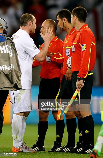 Wayne Rooney of England shakes hands with referee Ravshan Irmatov after the 2010 FIFA World Cup South Africa Group C match between England and...