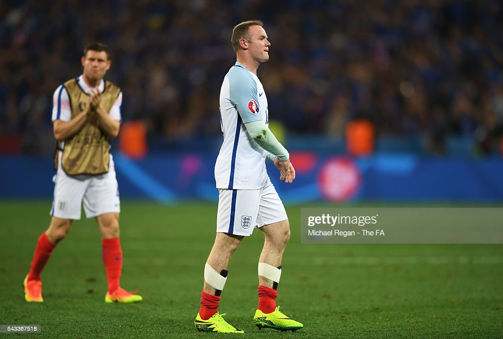 <a gi-track='captionPersonalityLinkClicked' href=/galleries/search?phrase=Wayne+Rooney&family=editorial&specificpeople=157598 ng-click='$event.stopPropagation()'>Wayne Rooney</a> of England shows his dejection after his team's 1-2 defeat in the UEFA EURO 2016 round of 16 match between England and Iceland at Allianz Riviera Stadium on June 27, 2016 in Nice, France.