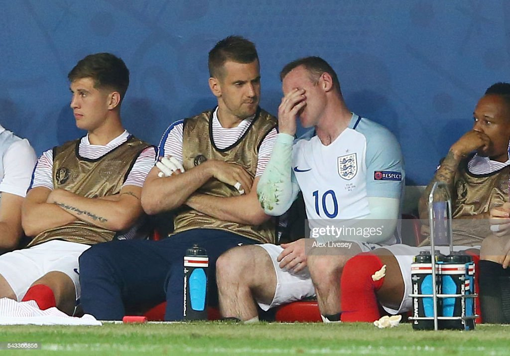 Wayne Rooney (2nd R) of England shows his frustration on the bench after being replaced during the UEFA EURO 2016 round of 16 match between England and Iceland at Allianz Riviera Stadium on June 27, 2016 in Nice, France.