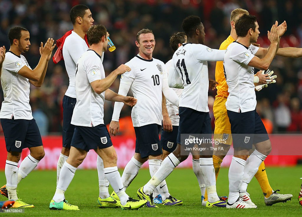 <a gi-track='captionPersonalityLinkClicked' href=/galleries/search?phrase=Wayne+Rooney&family=editorial&specificpeople=157598 ng-click='$event.stopPropagation()'>Wayne Rooney</a> of England smiles as he celebrates victory with his team mates at the final whistle during the FIFA 2014 World Cup Qualifying Group H match between England and Poland at Wembley Stadium on October 15, 2013 in London, England.