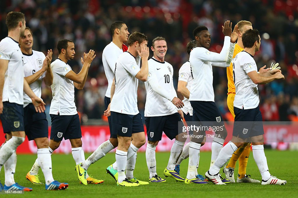 Wayne Rooney of England smiles as he celebrates victory with his team mates at the final whistle during the FIFA 2014 World Cup Qualifying Group H match between England and Poland at Wembley Stadium on October 15, 2013 in London, England.
