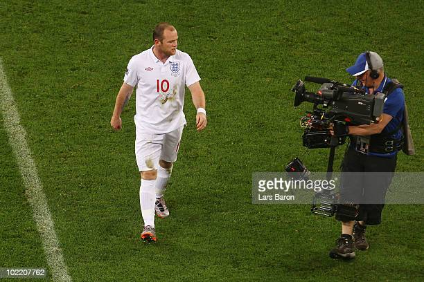 Wayne Rooney of England speaks into the camera as he walks off the pitch dejected after the 2010 FIFA World Cup South Africa Group C match between...
