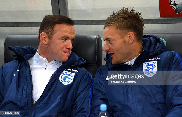Wayne Rooney of England speaks with teammate Jamie Vardy on the bench before the FIFA 2018 World Cup Qualifier Group F match between Slovenia and...