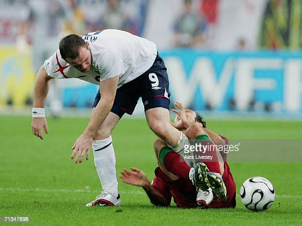 Wayne Rooney of England stamps on Ricardo Carvalho of Portugal during the FIFA World Cup Germany 2006 Quarterfinal match between England and Portugal...