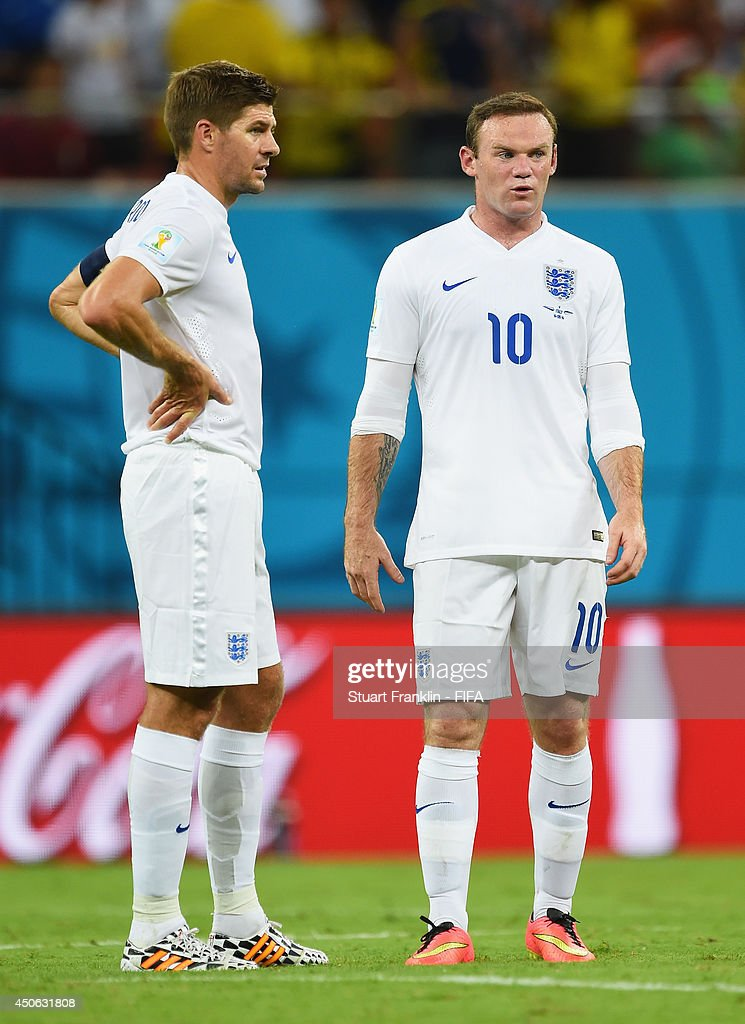 Wayne Rooney of England (R) talks with Steven Gerrard of England during the 2014 FIFA World Cup Brazil Group D match between England and Italy at Arena Amazonia on June 14, 2014 in Manaus, Brazil.