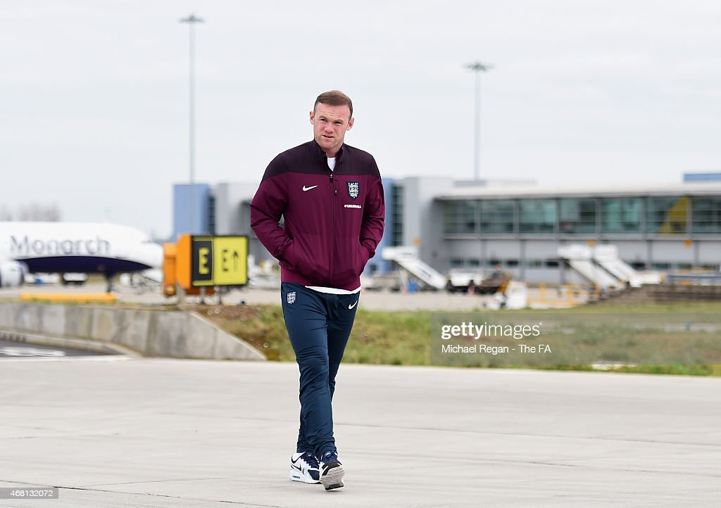 <a gi-track='captionPersonalityLinkClicked' href=/galleries/search?phrase=Wayne+Rooney&family=editorial&specificpeople=157598 ng-click='$event.stopPropagation()'>Wayne Rooney</a> of England walks to board the aeroplane for the International Friendly match against Italy at Luton Airport on March 30, 2015 in Luton, England.