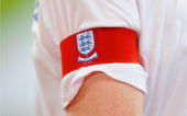 Wayne Rooney of England wears the captain's armband during the International Friendly match between Brazil and England at the Khalifa Stadium on...