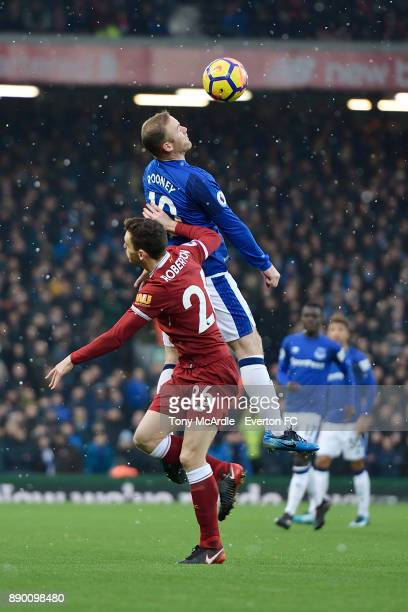 Wayne Rooney of Everton and Andrew Robertson challenge for the ball during the Premier League match between Liverpool and Everton at Anfield on...