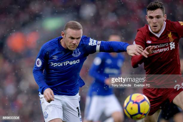 Wayne Rooney of Everton and Andrew Robertson during the Premier League match between Liverpool and Everton at Anfield on December 10 2017 in...