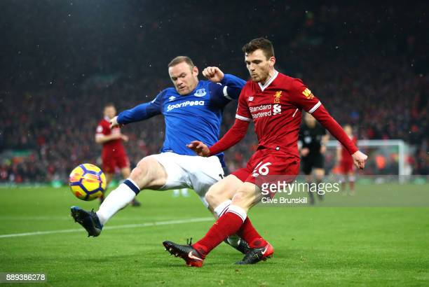 Wayne Rooney of Everton and Andy Robertson of Liverpool battle for possession during the Premier League match between Liverpool and Everton at...