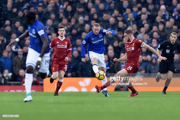 Wayne Rooney of Everton and Jordan Henderson challenge for the ball during the Premier League match between Liverpool and Everton at Anfield on...