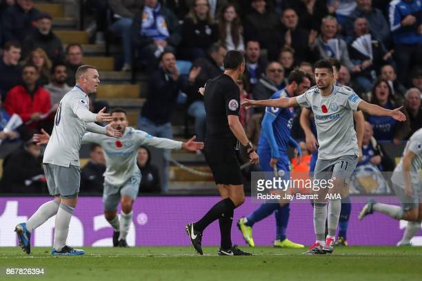 Wayne Rooney of Everton and Kevin Mirallas of Everton plead with Referee Andre Marriner after a penalty is not given during the Premier League match...