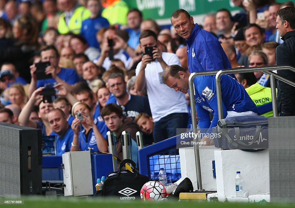 Wayne Rooney of Everton and Manchester United is watched closely by Duncan Ferguson before running on to the pitch to replace Tom Cleverley of Everton during the Duncan Ferguson Testimonial match between Everton and Villarreal at Goodison Park on August 2, 2015 in Liverpool, England.