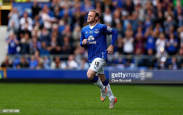Wayne Rooney of Everton and Manchester United runs on to the pitch as he replaces Tom Cleverley of Everton during the Duncan Ferguson Testimonial...