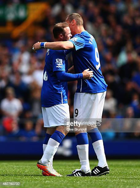 Wayne Rooney of Everton and Manchester United with Duncan Ferguson of Everton at the end of the Duncan Ferguson Testimonial match between Everton and...