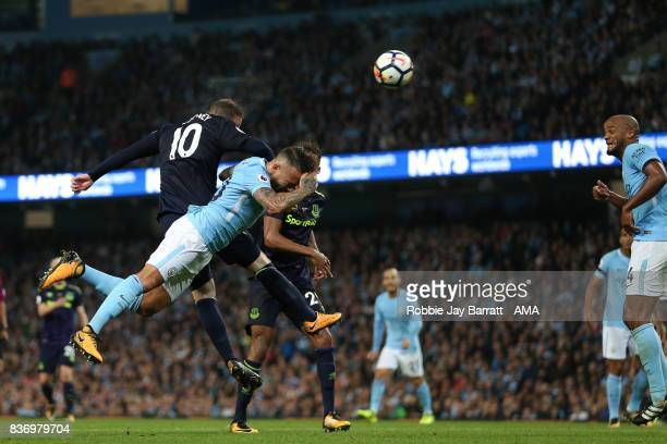 Wayne Rooney of Everton and Nicolas Otamendi of Manchester City during the Premier League match between Manchester City and Everton at Etihad Stadium...