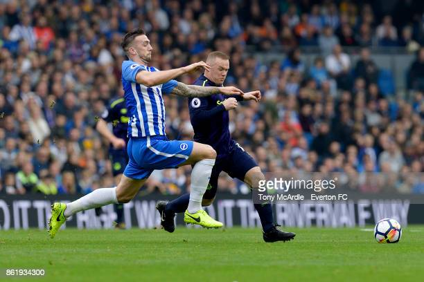 Wayne Rooney of Everton and Shane Duffy challenge for the ball during the Premier League match between Brighton and Hove Albion and Everton at Amex...