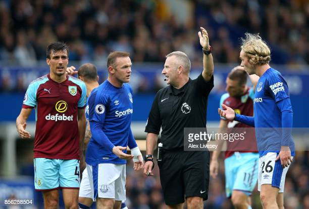 Wayne Rooney of Everton and Tom Davies of Everton argue with referee Jonathan Moss during the Premier League match between Everton and Burnley at...