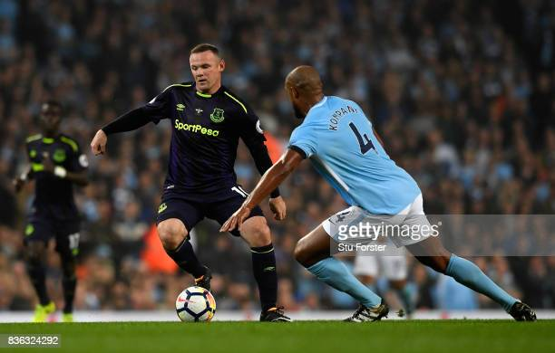 Wayne Rooney of Everton and Vincent Kompany of Manchester City in action during the Premier League match between Manchester City and Everton at...