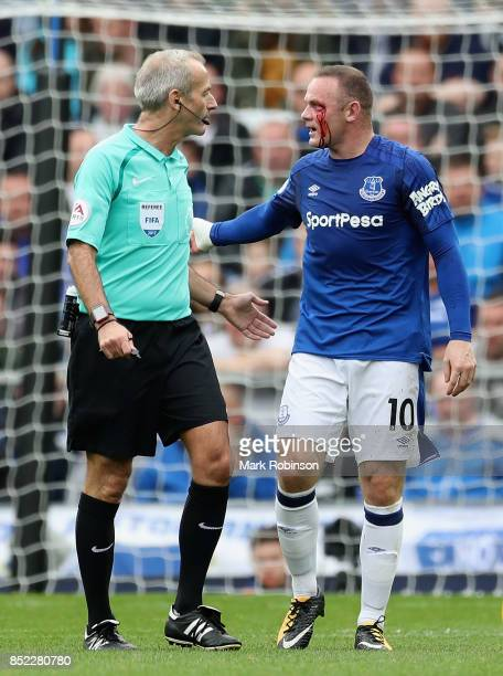Wayne Rooney of Everton appeals to referee Martin Atkinson during the Premier League match between Everton and AFC Bournemouth at Goodison Park on...