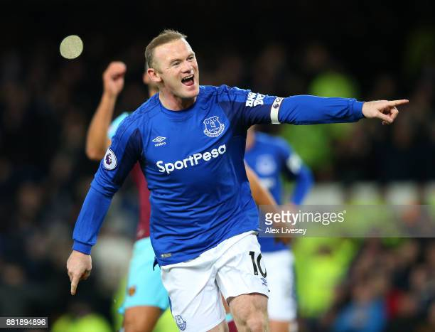 Wayne Rooney of Everton celebrates after scoring his sides first goal during the Premier League match between Everton and West Ham United at Goodison...