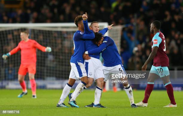 Wayne Rooney of Everton celebrates after scoring his sides third goal with Ashley Williams of Everton and Mason Holgate of Everton during the Premier...