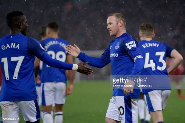Wayne Rooney of Everton celebrates his goal with Idrissa Gueye during the Premier League match between Liverpool and Everton at Anfield on December...