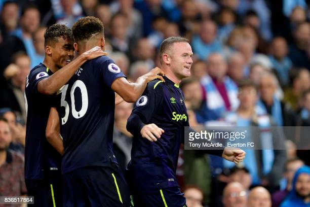 Wayne Rooney of Everton celebrates his goal with Mason Holgate and Dominic CalvertLewin during the Premier League match between Manchester City and...