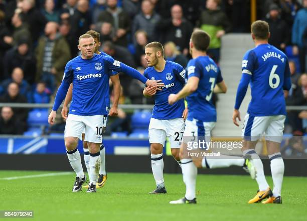 Wayne Rooney of Everton celebrates scoring his sides first goal with his Everton team mates during the Premier League match between Everton and...
