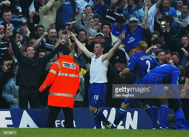 Wayne Rooney of Everton celebrates scoring the equalising goal during the FA Barclaycard Premiership match between Arsenal and Everton held on March...
