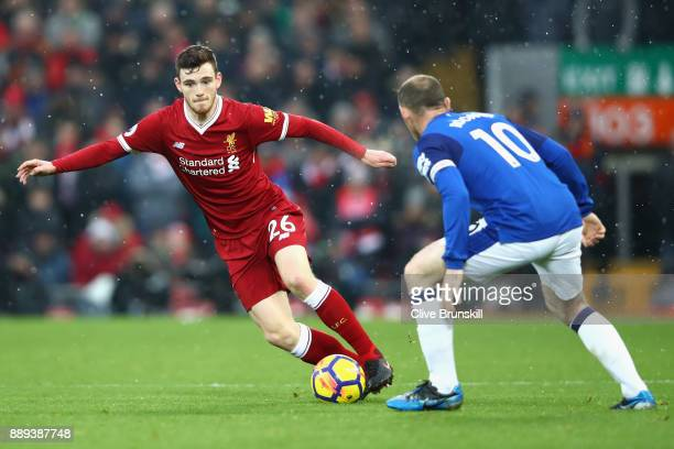 Wayne Rooney of Everton chases down Andy Robertson of Liverpool during the Premier League match between Liverpool and Everton at Anfield on December...