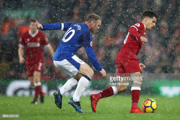 Wayne Rooney of Everton chases down Philippe Coutinho of Liverpool during the Premier League match between Liverpool and Everton at Anfield on...