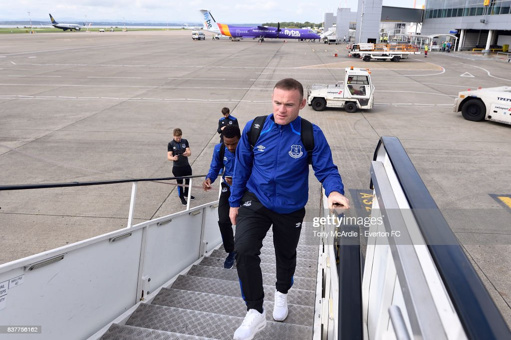 Wayne Rooney of Everton climbs the stairs as the Everton team depart for their UEFA Europa League match in Spilt at Liverpool John Lennon Airport on August 23, 2017 in Liverpool, England.