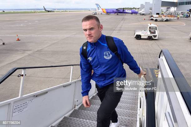 Wayne Rooney of Everton climbs the stairs as the Everton team depart for their UEFA Europa League match in Spilt at Liverpool John Lennon Airport on...