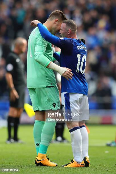 Wayne Rooney of Everton embraces Jack Butland of Stoke City at fulltime following the Premier League match between Everton and Stoke City at Goodison...