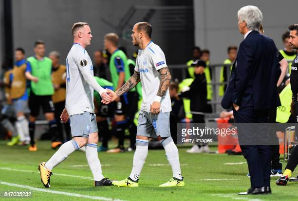 Wayne Rooney of Everton FC shakes hands with Sandro Ramirez of Everton FC after being substituted during the UEFA Europa League group E match between...