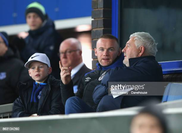 Wayne Rooney of Everton FC sits alongside his son and his agent Paul Stretford to watch the UEFA Europa League group E match between Everton FC and...