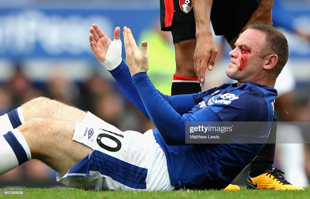 Wayne Rooney of Everton goes down injured with a face injury during the Premier League match between Everton and AFC Bournemouth at Goodison Park on September 23, 2017 in Liverpool, England.